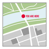 You are Here Map Flat Icon Isolated on White. Generic nameless city map flat icon with streets, green belts, a river and the text you are here, isolated on white Royalty Free Stock Images