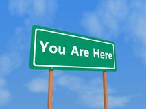 You Are Here Sign. Green Road Sign with the words You Are Here Stock Photos