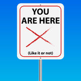 You are here sign. You are here like it or not sign with a blue background Royalty Free Stock Photos
