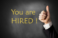 You are hired chalkboard thumbs up Stock Images