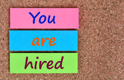You are hired words on notes. You are hired words on colorful notes Royalty Free Stock Photography