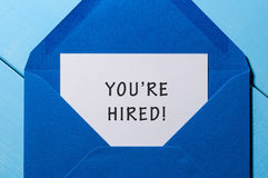 You are hiring phrase written in the paper at blue envelope. human resources concept.  Stock Image