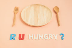 Are you hungry text with wooden plate and cutlery Stock Photo