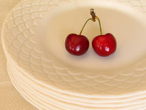 You are invited. Cherries on plate royalty free stock image
