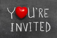 You are invited. Phrase handwritten on blackboard with heart symbol instead of O Stock Photo