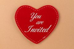 You are Invited. Red heart ot felt with german lettering  - You are invited Royalty Free Stock Photo