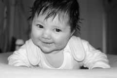 Are you kiddin' me?. Baby with the cutest face royalty free stock images