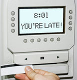 You are late!. Time clock showing the message You are late Stock Images