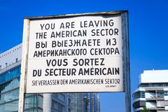 You are leaving the American sector Checkpoint Charlie. Sign indicating you are leaving the American sector at Checkpoint Charlie, the former border between East stock images