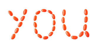 You lettering made of red candies isolated on white Stock Photography