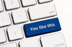 You like this button. Photo of like button on the white keyboard stock images