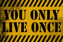 You only live once sign yellow with stripes Stock Photography