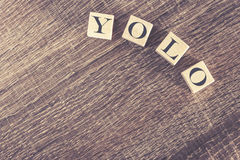 You Only Live Once (YOLO) message formed with wooden blocks Stock Images