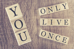 You Only Live Once (YOLO) message formed with wooden blocks Royalty Free Stock Photography