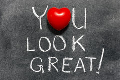 You look great. Exclamation handwritten on blackboard with heart symbol instead of O Royalty Free Stock Photos
