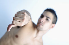 You lost: the fight knocked out. A young man with his thumb down tells you lost Royalty Free Stock Photography