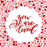 You are loved calligraphic phrase surrounded by colorful heart pattern. Vector banner template Stock Photography