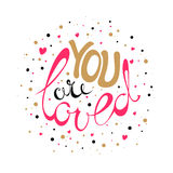 You are loved card. Vector Valentines Day hand drawn text You are loved. Gold and pink on white background. Valentine Day design card Stock Image