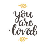 You are Loved hand drawn brush lettering. Isolated on white. Valentine gift card, poster. Typography design for photography overlay, T shirt, wedding Royalty Free Stock Photo