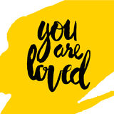 You are loved hand lettering. Black lettering You are loved  hand brush Royalty Free Stock Photo