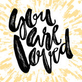 You are loved-romantic love confession hand lettering motivation Royalty Free Stock Image