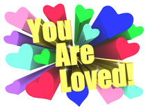 You Are Loved slogan. Golden text with vivid stars Stock Images