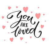 You are loved. Valentine`s day card text with pink hearts. Royalty Free Stock Photos