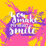 You make my heart smile - hand drawn lettering phrase on the colorful sketch background. Stock Photo