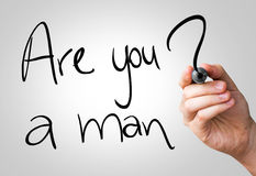 Are you a man hand writing with a black mark on a transparent board.  stock photos