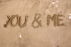 You and Me. Drawing on the sand - You and Me Stock Photo