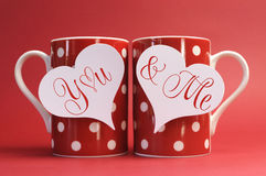 You and Me, love message greeting on heart gift tags on red polka dot coffee mugs. For Valentines Day, Mothers Day, birthday, wedding or loving occasion royalty free stock images
