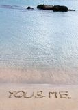 You and me message written in the sand on a beautiful beach Royalty Free Stock Images