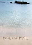 You and me message written in the sand on a beautiful beach Royalty Free Stock Photo