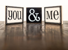 You & Me on Mottled Tabletop Royalty Free Stock Image