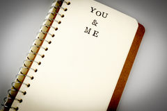 You and me text in emty book or diary Royalty Free Stock Photography