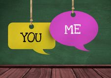 You Me text on hanging paper speech bubbles. Digital composite of You Me text on hanging paper speech bubbles Stock Photo