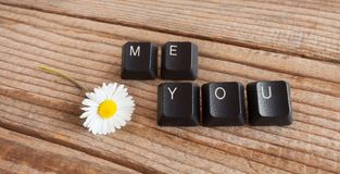You and me wrote with keyboard keys on wooden background. You and me wrote with  keyboard keys on wooden background Royalty Free Stock Photography