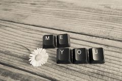 You and me wrote with keyboard keys on wooden background, blac. K and white effect Royalty Free Stock Image