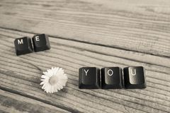 You and me wrote with keyboard keys on wooden background, blac. K and white effect Stock Photography
