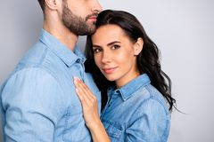 You are mine forever Cropped portrait of beautiful attractive casual lady cuddling her mr right wearing denim shirt. You are mine forever! Cropped portrait of stock images