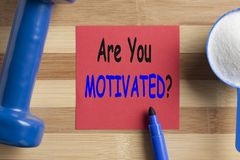 Are You Motivated Concept. Are You Motivated written on note and scoop with creatine and dumbbell. Fitness motivation stock images