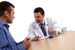 You must be strong Sir. Doctor explaining diagnosis to male patient stock photo