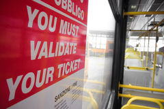 You must validate your ticket on city bus Stock Photos