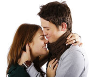 You are my hiding place. Young attractive couple passionately in love hugging and laughing isolated on white Stock Photos