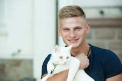 You are my little furry friend. Happy man on walk with cat pet. Muscular man hold cute pedigree cat. Happy cat owner stock photography