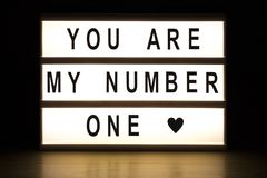 You are my number one light box sign board. On wooden table stock photo