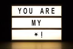 You are my star light box sign. Board on wooden table royalty free stock photos