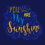 You are my sunshine on blue. Lettering, message: you are my sunshine on blue background. Hand drawn vector illustration. Hand lettering romantic quote for cards royalty free illustration