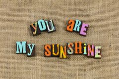 You are my sunshine laughter. Make me happy happiness joy laughter only sunshine sun sunny burlap cloth background love romance couple lover romance stock photos