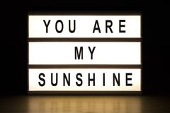 You are my sunshine light box sign board. On wooden table royalty free stock photos